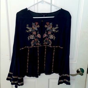 Navy and floral bell sleeve top